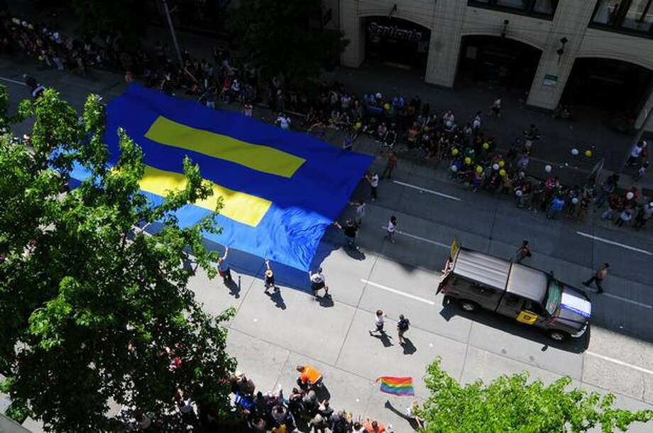 The HRC float drives down 4th Avenue during the Seattle Pride Parade. Photo: Daniel Berman, Seattlepi.com
