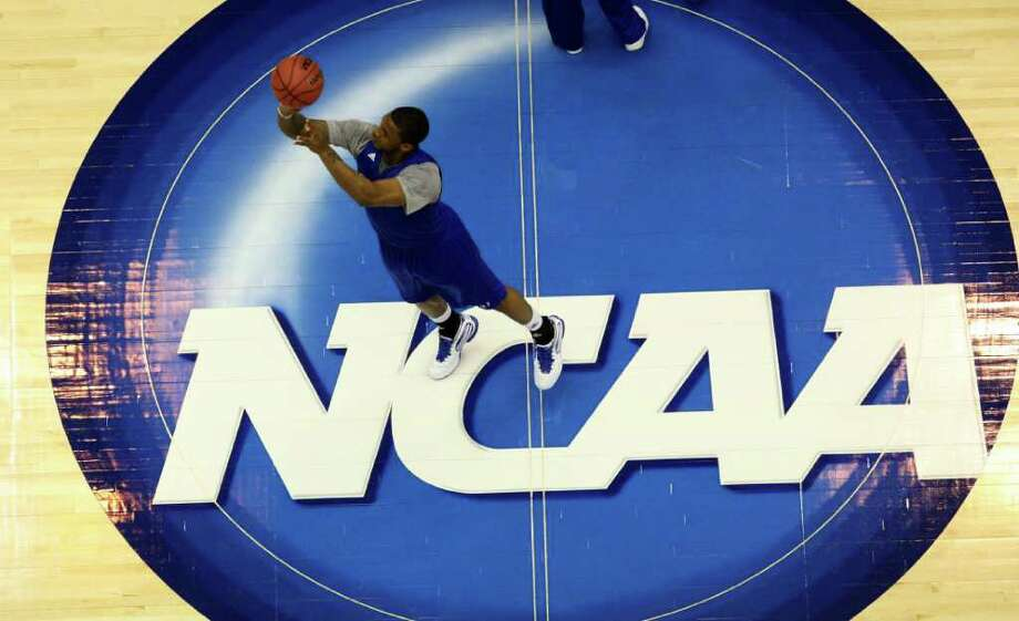 Kansas forward Thomas Robinson (0) shoots from half court during practice at the NCAA Southwest Regional basketball tournament in San Antonio on Thursday, March 24, 2011. Photo: Edward A. Ornelas, SAN ANTONIO EXPRESS-NEWS / San Antonio Express-News NFS