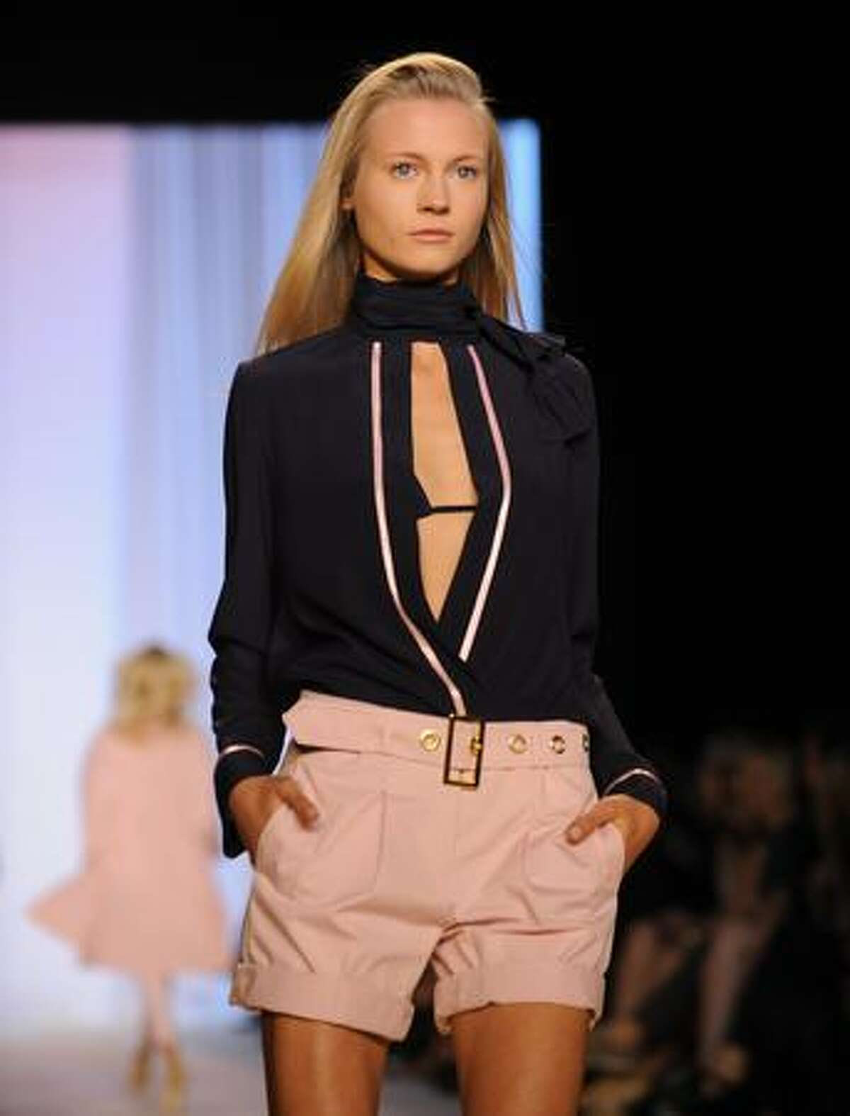 A model displays a creation by Tommy Hilfiger.