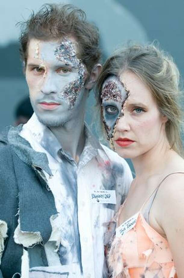 A couple of zombies pose during an attempt to break the Guinness World Record for largest zombie gathering in Fremont. Photo by Daniel Berman/SeattlePI.com Photo: Daniel Berman, Seattlepi.com