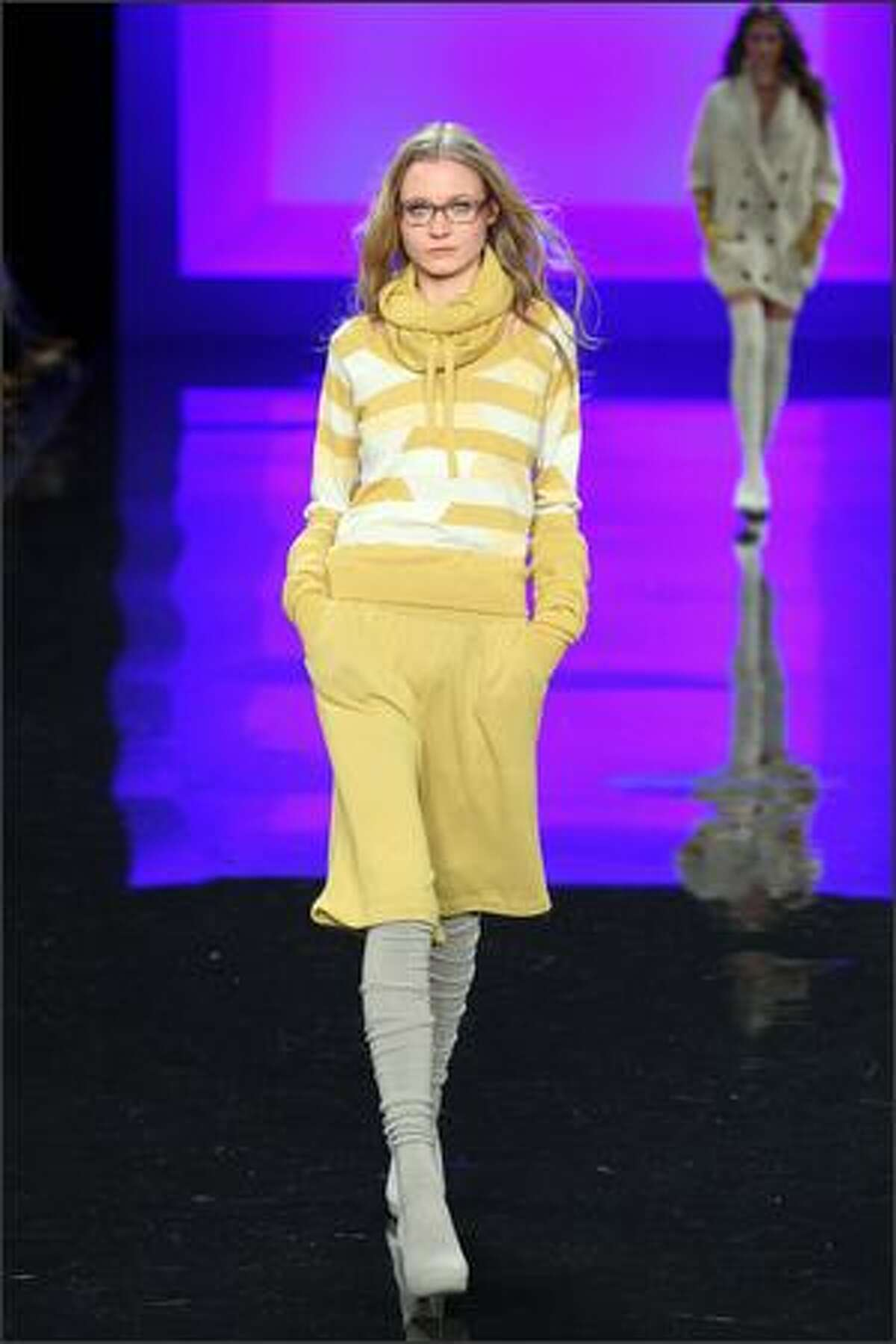 A model walks the runway at the Lacoste Fall 2009 fashion show during Mercedes-Benz Fashion Week in the Tent at New York's Bryant Park on Saturday, Feb. 14, 2009.