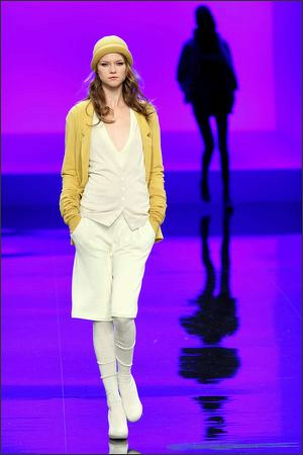 A model walks the runway at the Lacoste fashion show.