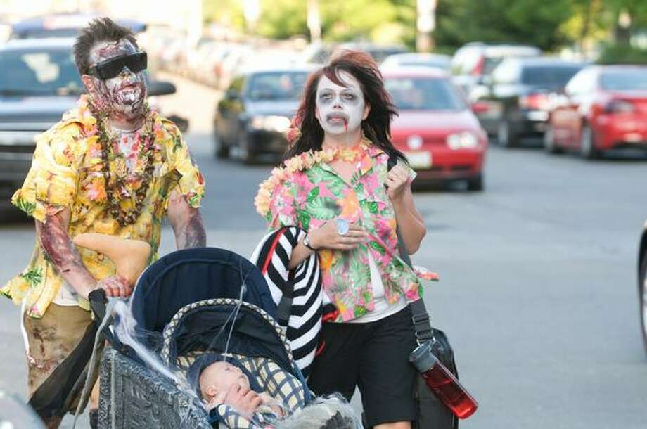 A zombie family walks around Phinney Avenue during the event. Photo by Daniel Berman/SeattlePI.com Photo: Daniel Berman, Seattlepi.com
