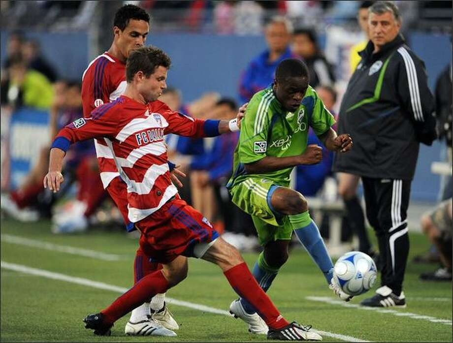 Forward Steve Zakuani #11 of the Seattle Sounders FC dribbles the ball against Drew Moor #3 of FC Dallas. (Photo by Ronald Martinez/MLS via Getty Images) Photo: / Getty Images