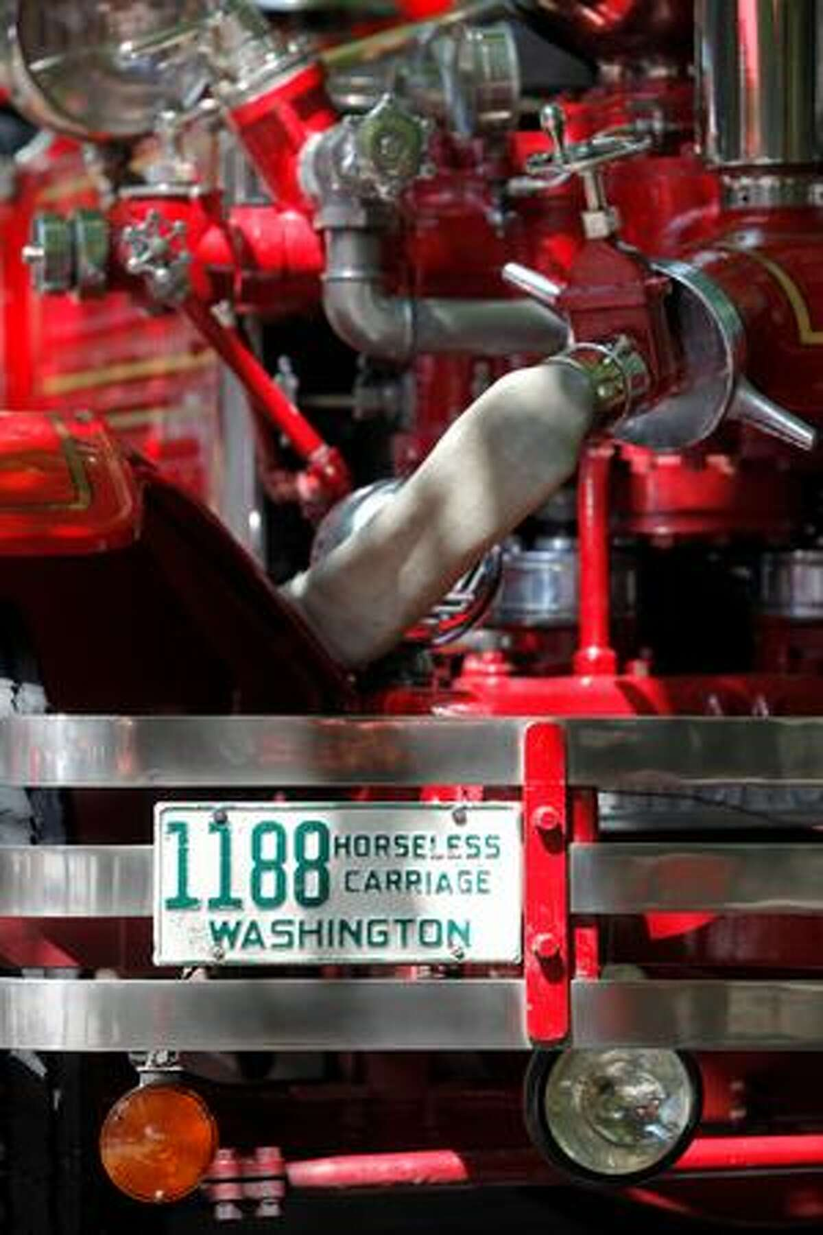 A 1927 Ahrens-Fox Piston Pumper sits on display during the Pioneer Square Fire Festival in Seattle.