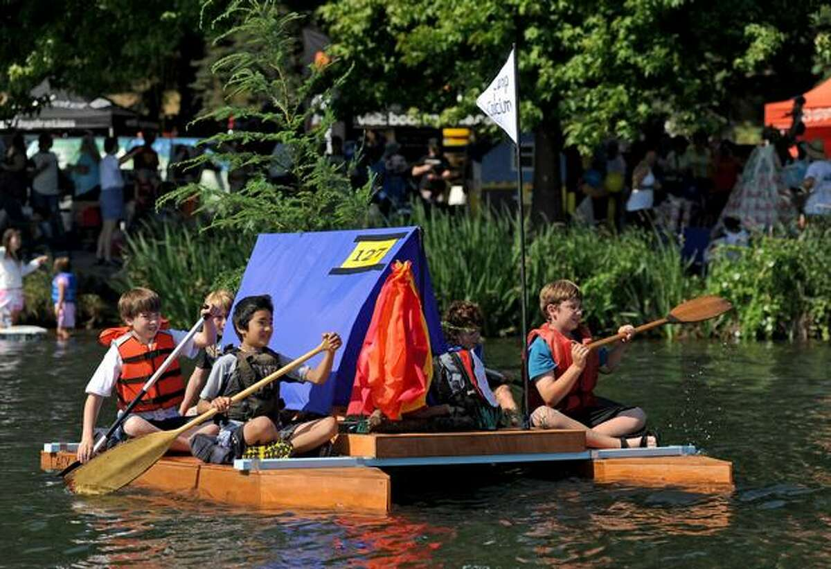 The Camp Calcium boat is shown in the Parade of Boats at Seattle's Seafair Milk Carton Derby on Green Lake Saturday.
