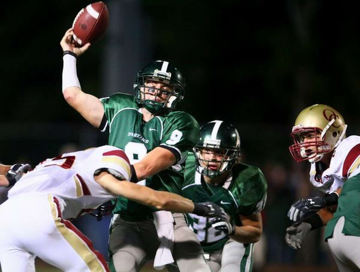Skyline High School quarterback Jake Heaps is hit by a Oaks Christian player as he loses control of the ball and results in a turnover during Skyline's final possesion of the game.