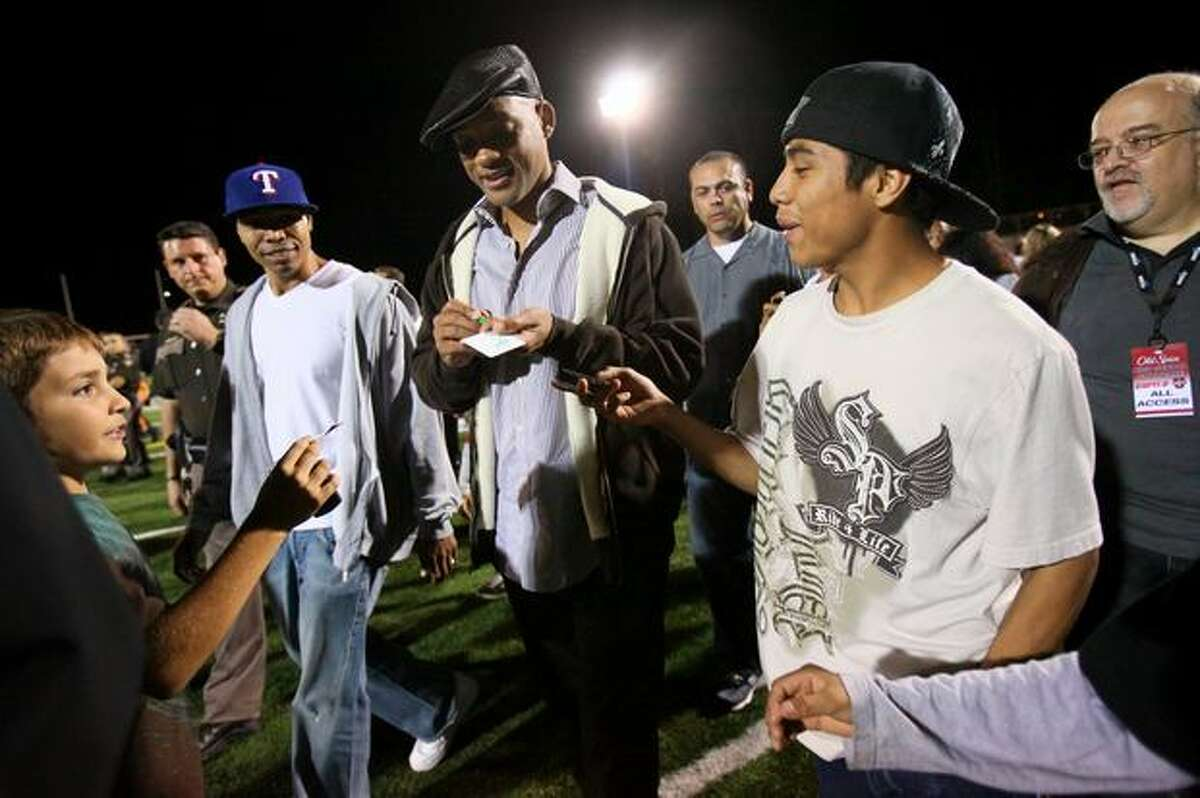 Actor Will Smith signs autographs for fans after a game between Oaks Christian and Skyline High School on Friday September 18, 2009. Smith's son Trey is a wide receiver for the California high school's team. Oaks Christian and Skyline battled it out in a nationally televised game.