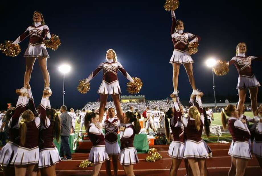 Oaks Christian cheerleaders perform for their fans during a nationally televised high school football game against Skyline. Photo: Joshua Trujillo, Seattlepi.com