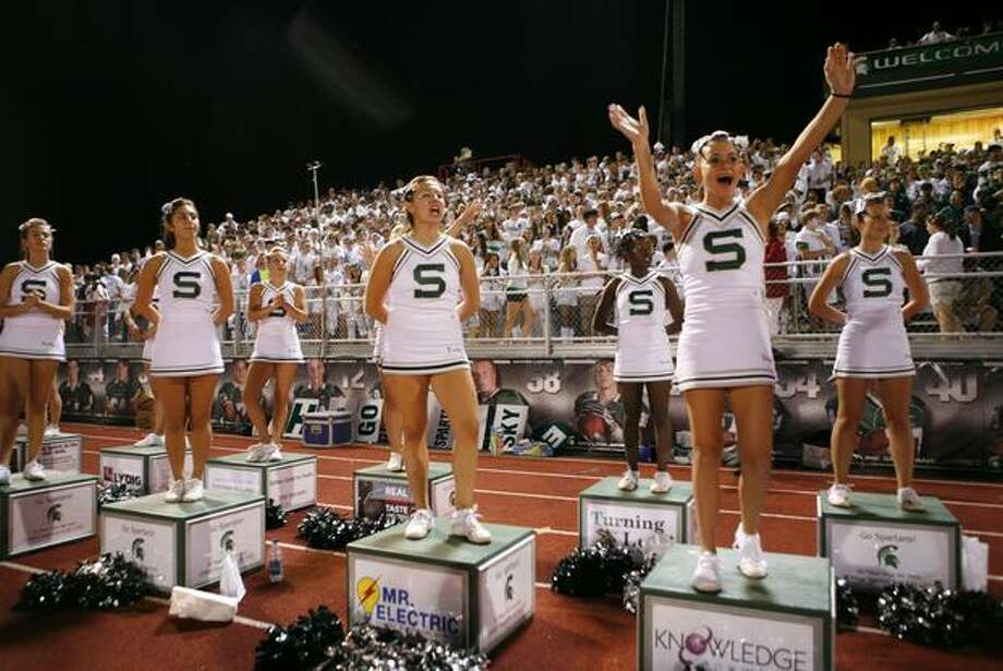 Skyline High School cheerleaders cheer for their team during a game against Oaks Christian High School. Photo: Joshua Trujillo, Seattlepi.com
