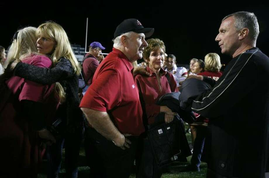 Joe Montana, father of Oaks Christian quarterback Nick Montana, talks with head coach Bill Redell, a member of the College Football Hall of Fame, after their team defeated Skyline High School. Photo: Joshua Trujillo, Seattlepi.com