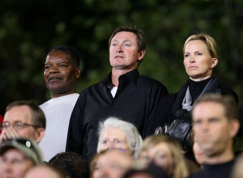 Wayne Gretzky, center, and his wife Janet Jones watch the game between Oaks Christian and Skyline Hi