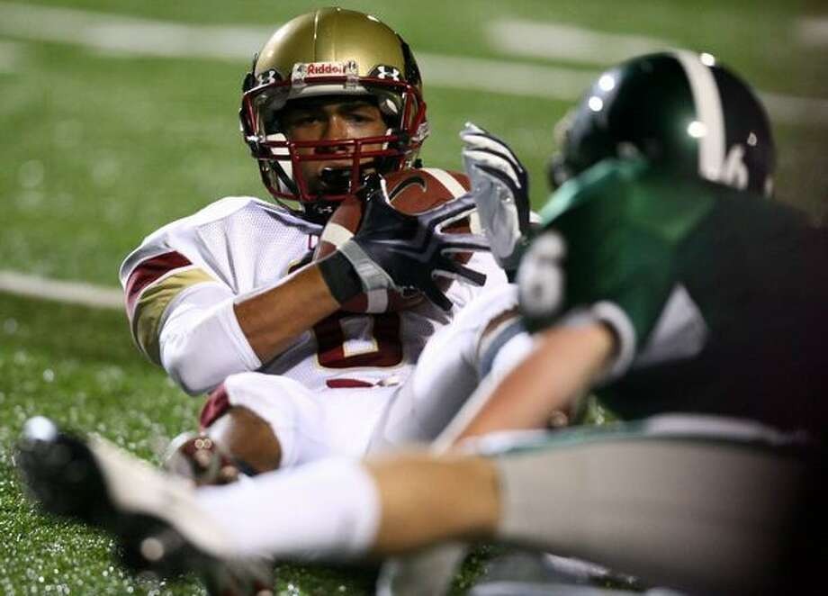 Oaks Christian player Trey Smith holds onto the ball against Skyline High School player Tait Stephens. Smith is the son of actor Will Smith who attended the game to watch his son. Photo: Joshua Trujillo, Seattlepi.com
