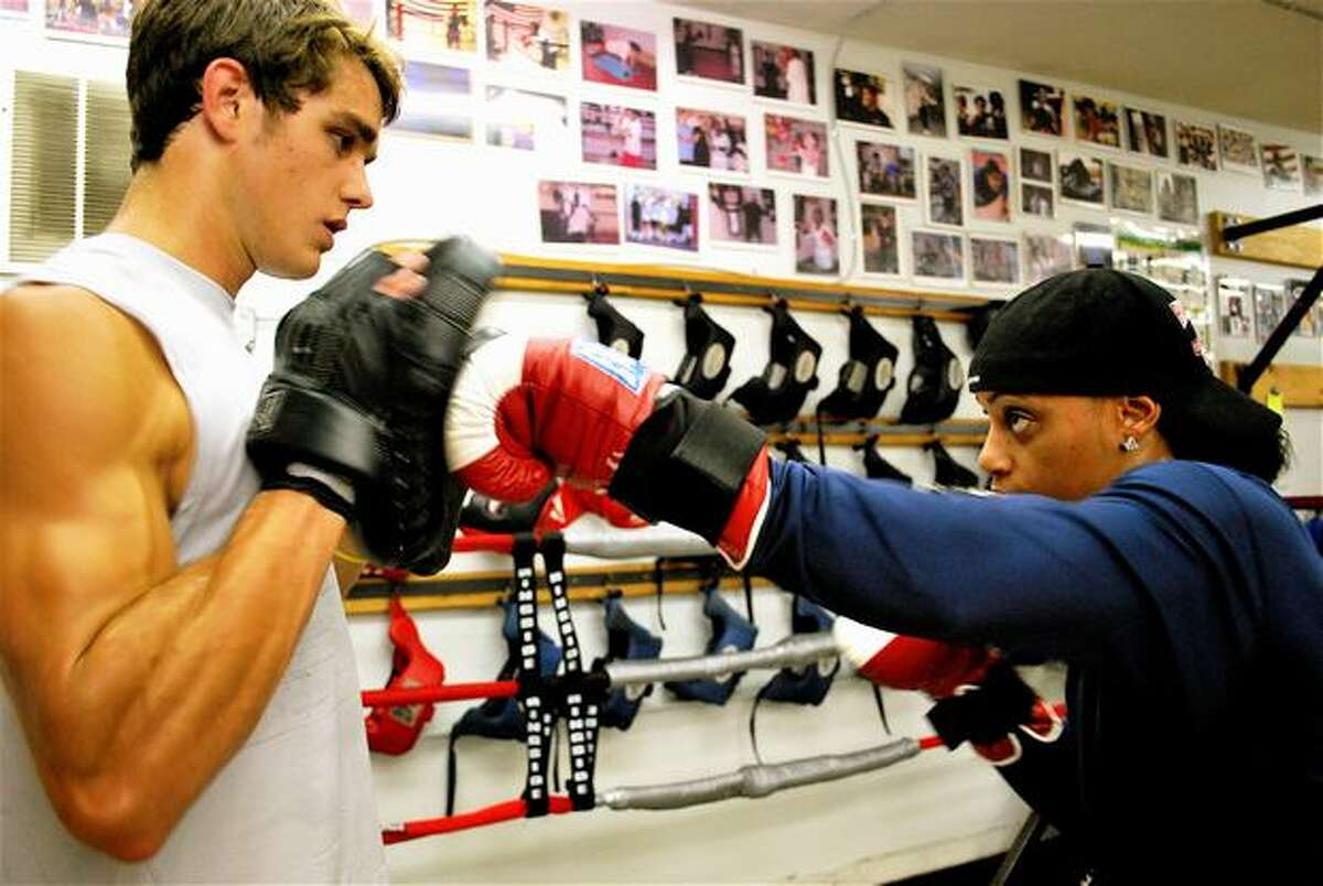 USA boxing champ Queen Underwood works out with Joe Byers, 21, a student at the University of Washington. The two are boxers at Cappy's Boxing Gym on 22nd Ave. and East Union in Seattle.