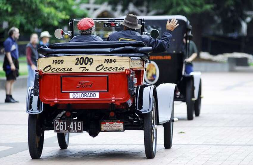 Ford Model T's from the 1909 Ocean to Ocean reenactment race make their way onto the University of Washington campus Sunday.