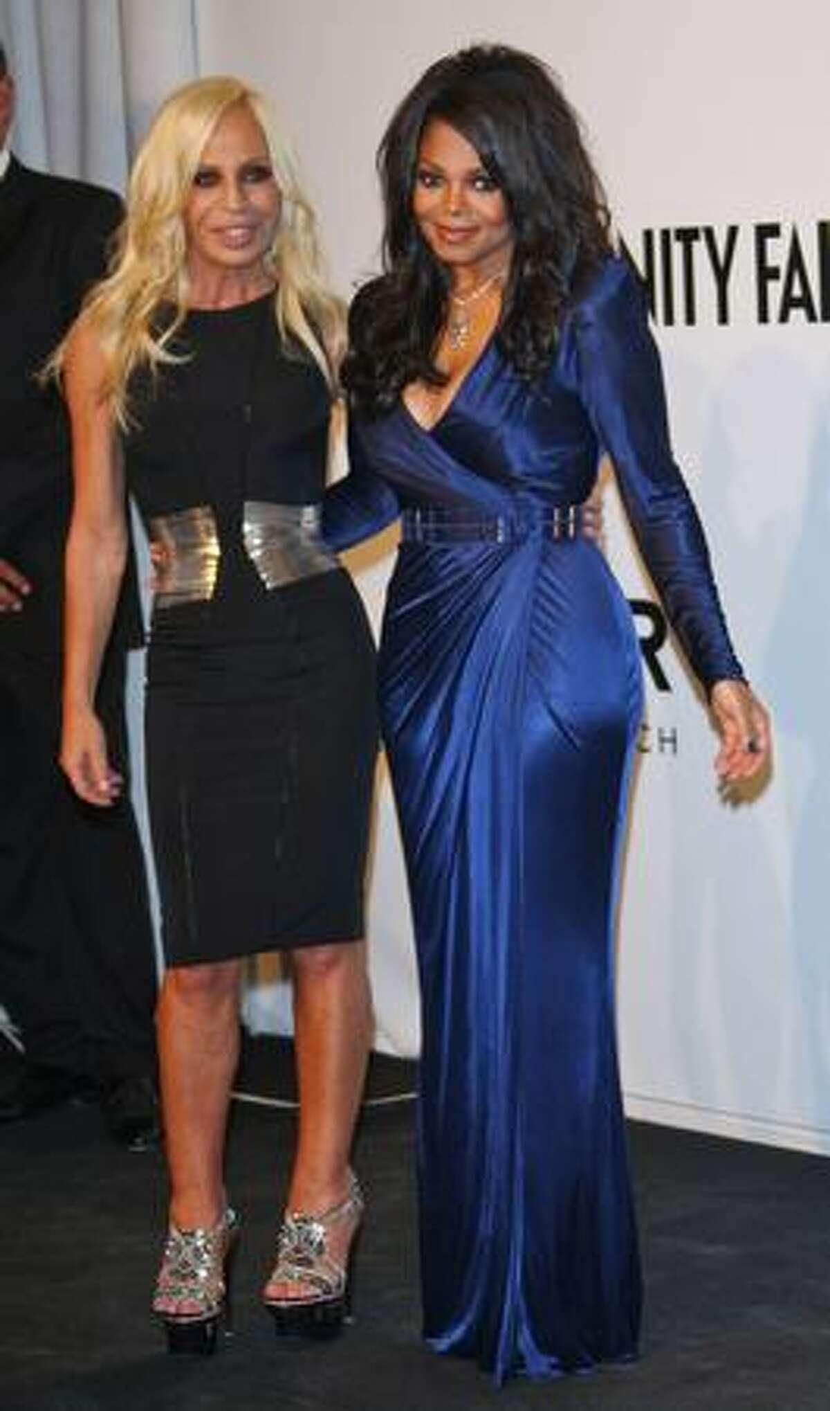 Designer Donatella Versace and Janet Jackson arrive.