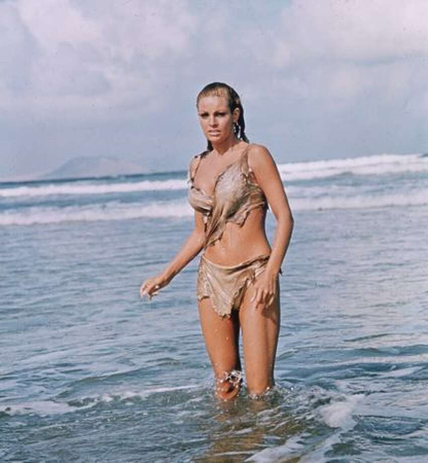 "1966: Actress Raquel Welch in a scene from the film ""One Million Years B.C."" What else would the prehistoric woman wear but a bikini made from animal skins? Photo: Getty Images"