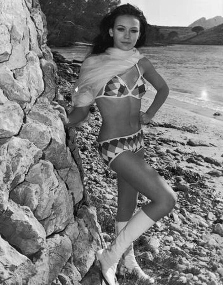 1970: British-born actress and model Lesley-Anne Down shows the lingering effects of the '60s in a bikini, go-go boots and a scarf. She was just 15. Photo: Getty Images
