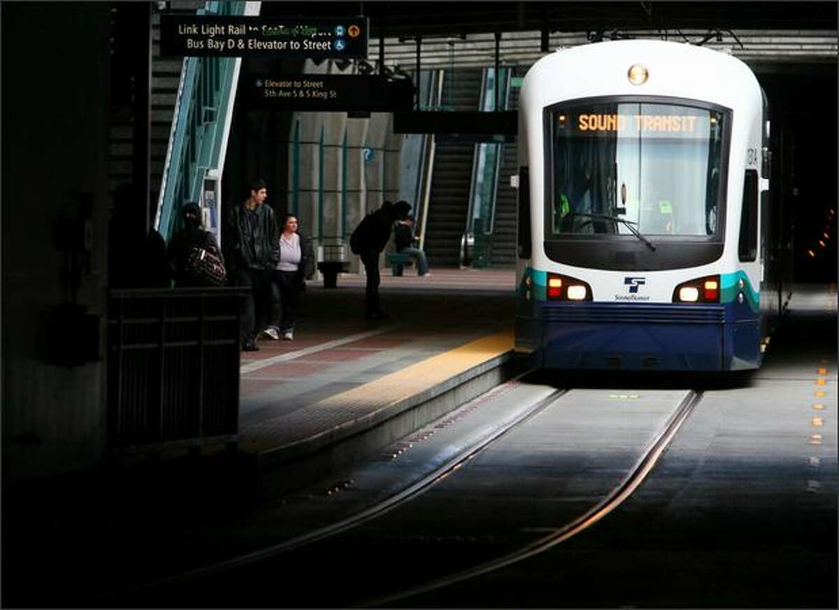 A Sound Transit train makes its way through the Downtown Seattle Transit Tunnel during testing of the city's new light-rail system. Link, which will connect downtown Seattle to Sea-Tac International Airport and points in between, is scheduled to begin service in July.