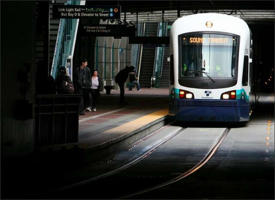 A Sound Transit train makes its way through the Downtown Seattle Transit Tunnel during testing of the city's new light-rail system.  Link, which will connect downtown Seattle to Sea-Tac International Airport and points in between, is scheduled to begin service in July. Photo: Joshua Trujillo/seattlepi.com