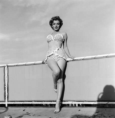It didn't take long for the bikini to be embraced around the world. In Hollywood, a young starlet named Marilyn Monroe gave the bikini a sex appeal it perhaps had not displayed until this 1951 portrait. Photo: Getty Images