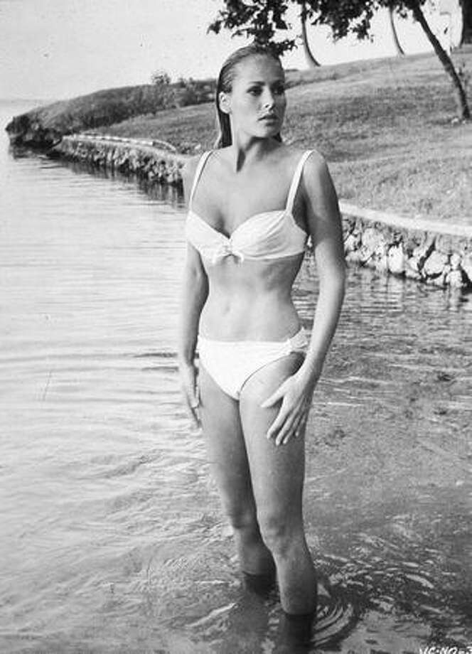 "1962: Swiss actress Ursula Andress redefines what it means to wear a bikini with this, one of the most famous swimsuits in movie history, from the James Bond film ""Doctor No."" Photo: Getty Images"