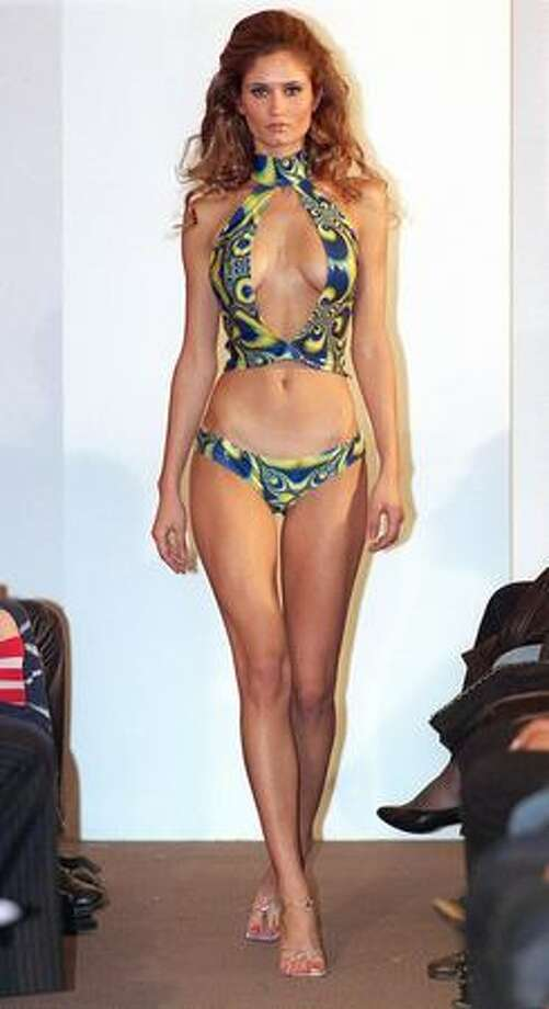 Finally, we finish with a contemporary display to show you just how far the bikini has come in 65 years. A model presents a bikini by Portuguese designer Fatima Lopes in Paris. Photo: Getty Images