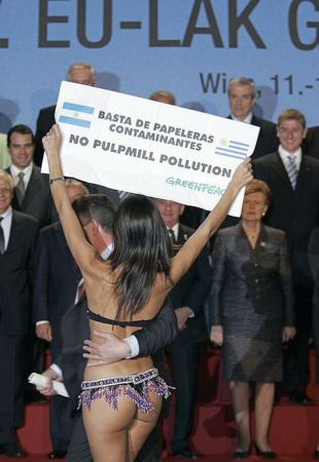"A bikini is sure to get the attention of politicians, right? This Greenpeace demonstrator wearing a bikini is dragged away by security as she shows a banner against pulp mill plant installation in Uruguay during a group picture of the heads of state of European and Latin American countries in Vienna in May 2006. The banner reads: ""Stop contaminant paper mill plants."" Photo: Getty Images"