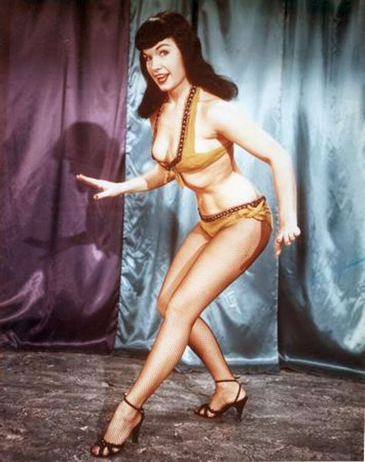 Circa 1955: American glamour model and pin-up girl Bettie Page, one of the few women alive who could become more demure by actually wearing a bikini. Photo: Getty Images
