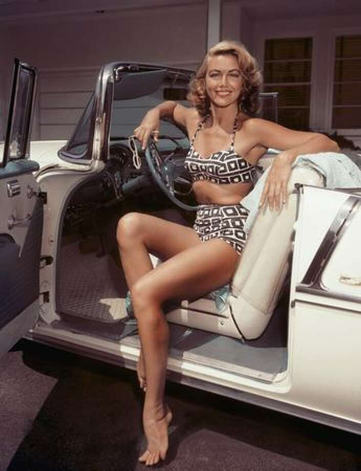 Circa 1955: By the mid-'50s, every American glamourpuss worth her salt was photographed in a bikini. Here's actress Dorothy Malone at the wheel of a cream-colored convertible. Photo: Getty Images