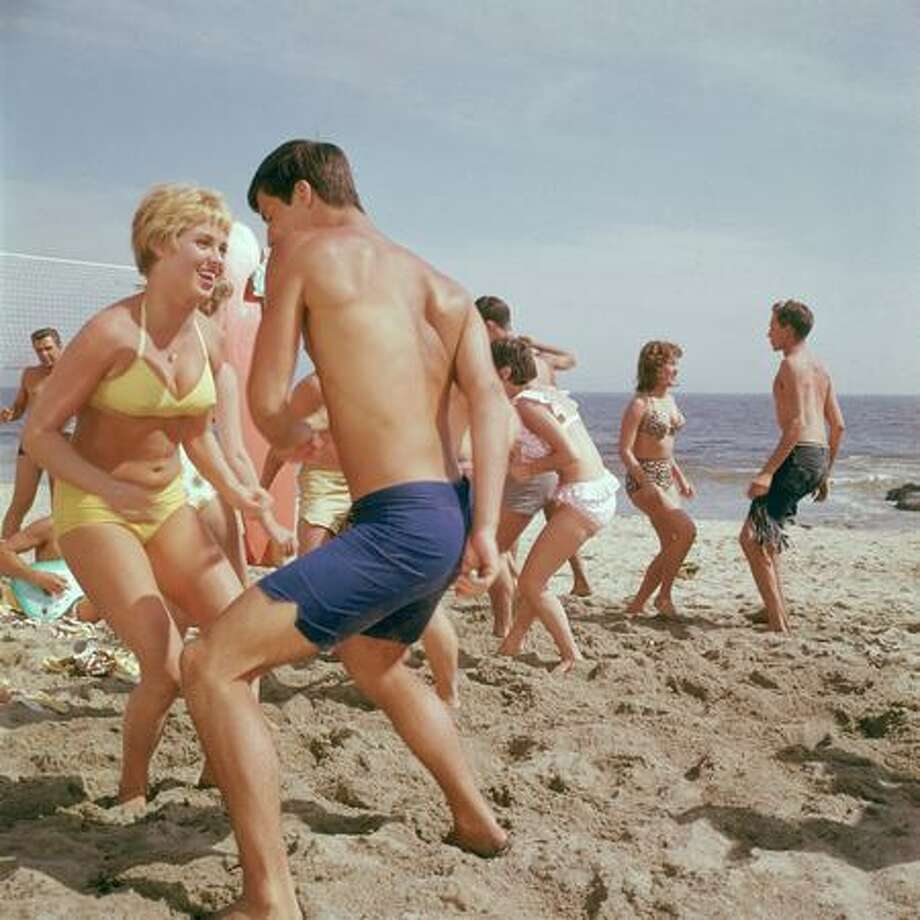 Ah, the '60s. Bikinis and rock 'n' roll just seemed to go together at the beach. Photo: Getty Images