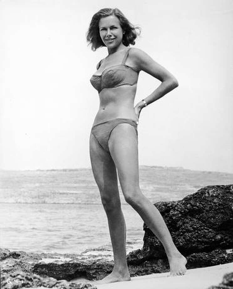 """1964: British actress Honor Blackman continues the tradition on the set of the James Bond film """"Goldfinger."""" Photo: Getty Images"""