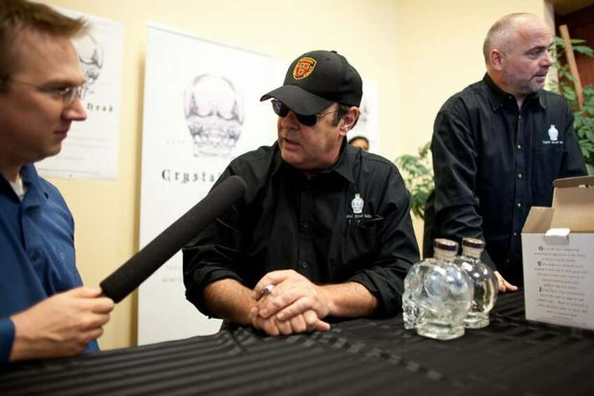 Aykroyd takes a break from signing bottles to talk to the press. He will be signing bottles at the University Village liquor store from 4 p.m. to 6 p.m. on Wednesday.