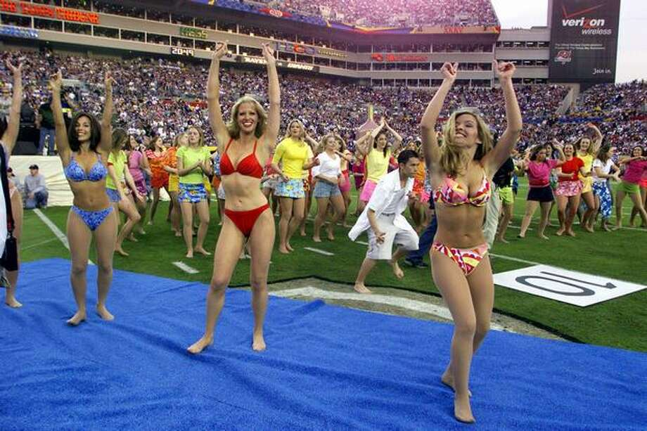 "Bikinis and football -- why not? These dancers perform before the start of Super Bowl XXXV January 2001 in Tampa, Fla., between the New York Giants and the Baltimore Ravens. Much tamer than some ""wardrobe malfunction."" Photo: Getty Images"