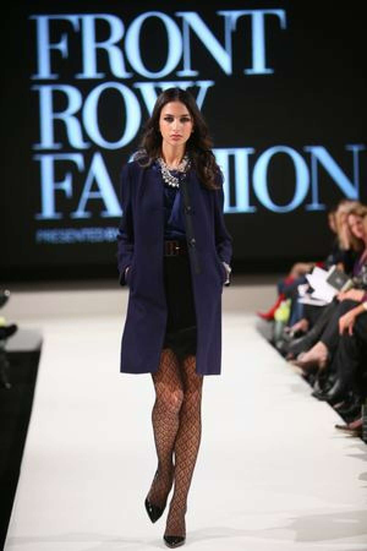A model walks the runway during Vogue's Front Row Fashion show at the Hyatt Regency Bellevue.