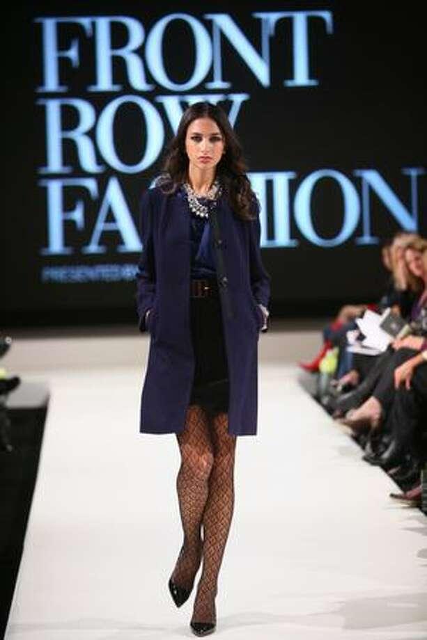 A model walks the runway during Vogue's Front Row Fashion show at the Hyatt Regency Bellevue. Photo: Joshua Trujillo, Seattlepi.com