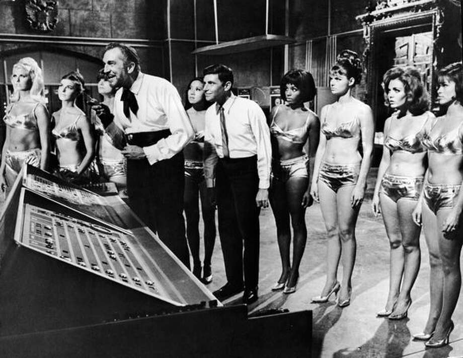 "1965: American filmmakers went through a silly phase in which the word bikini was not only in the titles of many films but an excuse to populate those films with young starlets wearing them. Here, actors Vincent Price (left) and Dwayne Hickman are surrounded in a lab by unidentified actresses in bikinis in a still from the film ""Dr. Goldfoot and the Bikini Machine."" Photo: Getty Images"