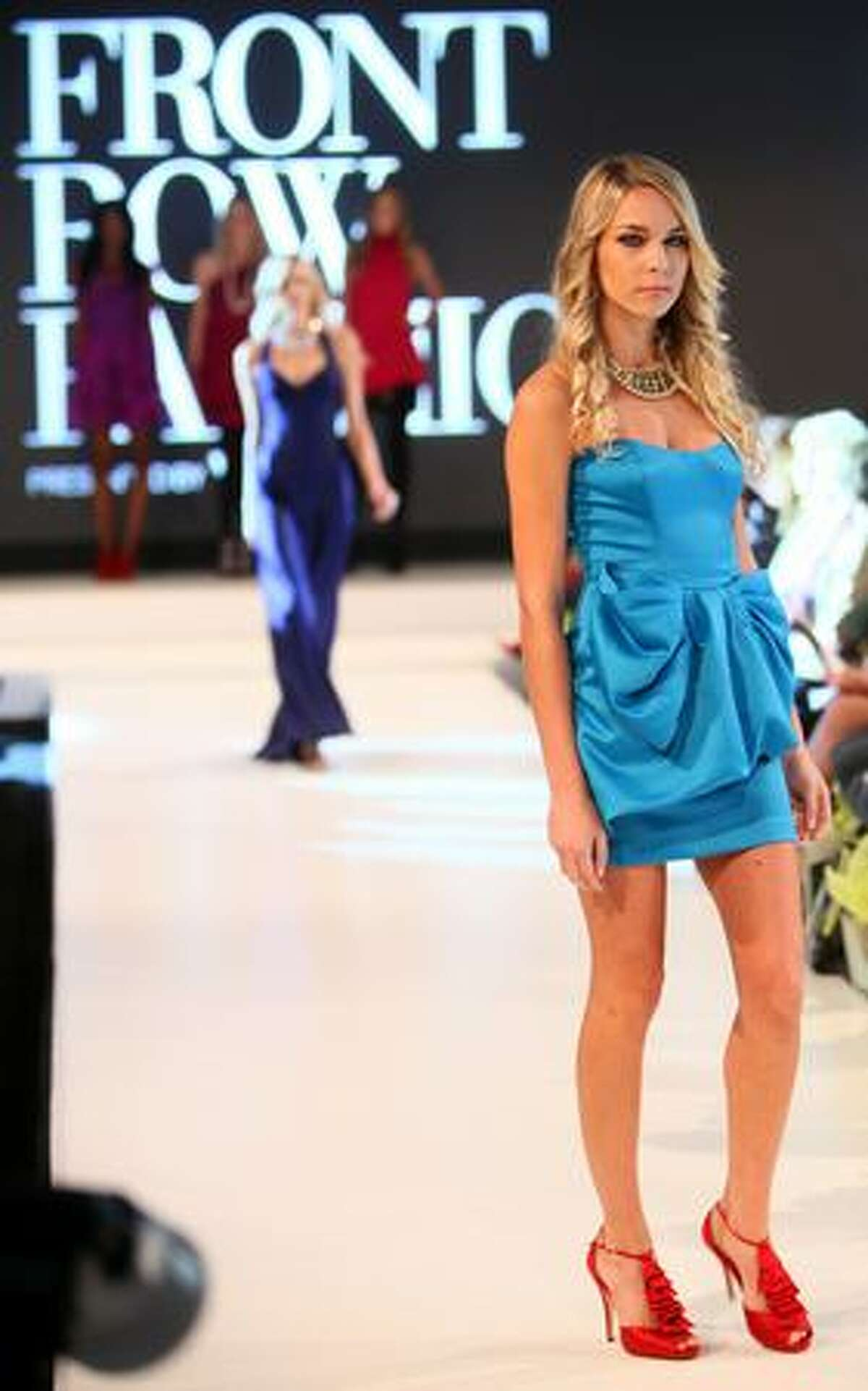 Models walk the runway during Vogue's Front Row Fashion show at the Hyatt Regency Bellevue.