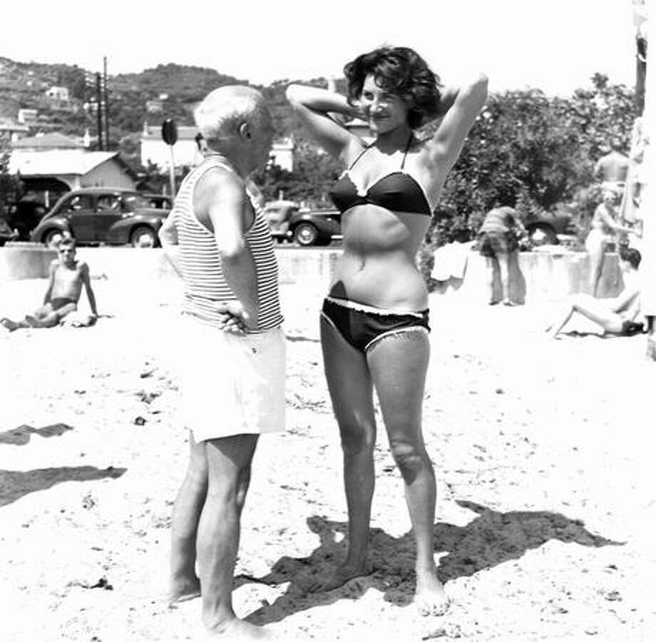 Spanish painter Pablo Picasso admires a young woman wearing a bikini on the French Riviera in the 1960s. Photo: Getty Images