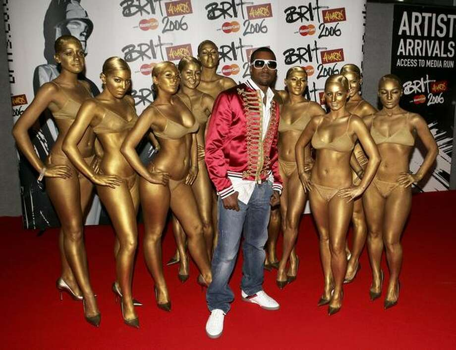 Kanye West shows how he rolls with his bikini-clad dancers at The Brit Awards 2006 in London. Photo: Getty Images