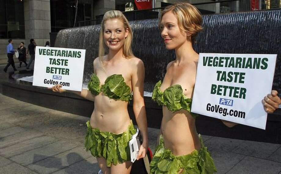 "It's not a new idea, of course, and we probably haven't seen the last of it. These two Aussies, wearing nothing but bikinis made of real lettuce leaves, urge commuters and passersby to go vegetarian during a PETA protest in Sydney in May 2007. The ""Lettuce Ladies"" were drawing attention to the health and environmental issues related to eating meat. Photo: Getty Images"