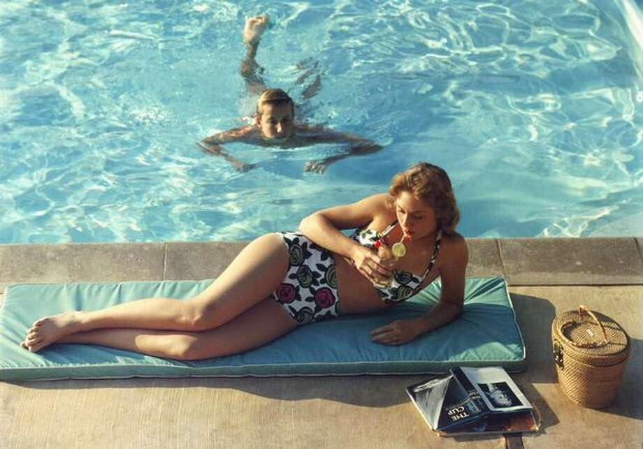 1957: Relaxing by a pool at Laguna Beach, San Diego. The bikini would soon become virtually unimaginable without being in the same thought as any Southern California beach. Photo: Getty Images