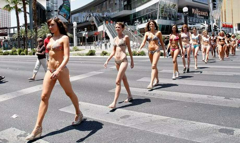 "These ""publicity tools"" march across the Las Vegas Strip as they help the Las Vegas Convention & Visitors Authority earn a Guinness World Record for staging the world's largest bikini parade with 281 participants. Photo: Getty Images"