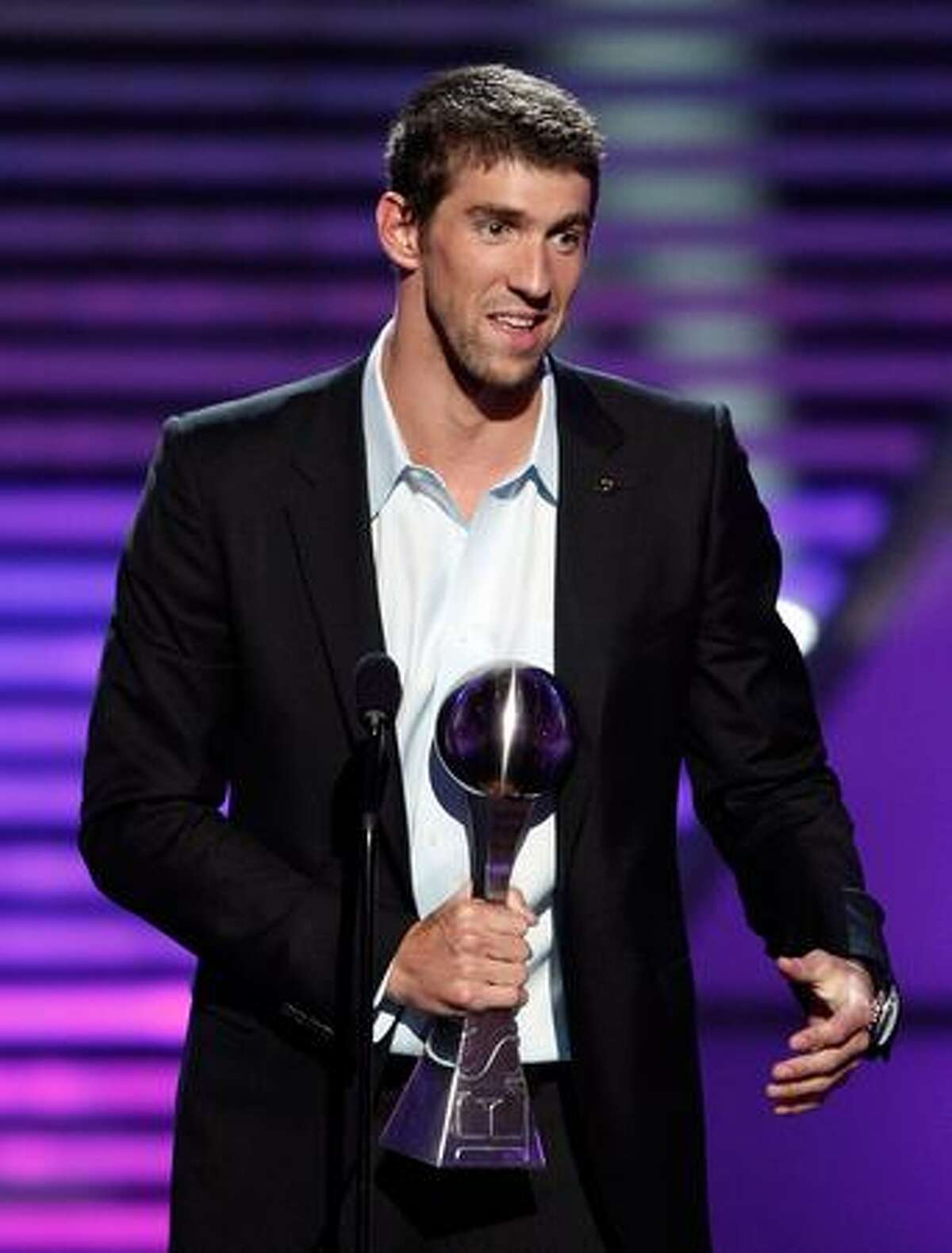 Olympic gold medalist swimmer Michael Phelps accepts the Best Championship Performance award onstage during the 2009 ESPY Awards held at Nokia Theatre LA Live in Los Angeles on Wednesday, July 15, 2009. The 17th annual ESPYs will air on Sunday, July 19 at 6 p.m. PDT on ESPN.
