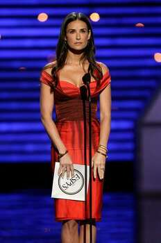 Actress Demi Moore presents an award onstage. Photo: Getty Images