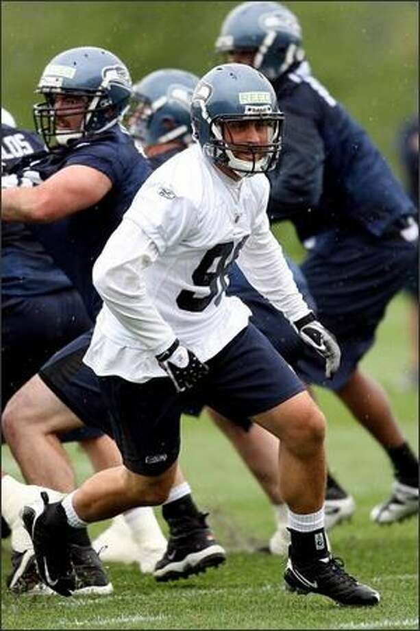 Defensive end Nick Reed runs drills during Seahawks minicamp May 2. Reed wasn't invited to the NFL Combine despite getting 25 sacks in his final two seasons at Oregon. (Otto Greule Jr/Getty Images) Photo: / Getty Images