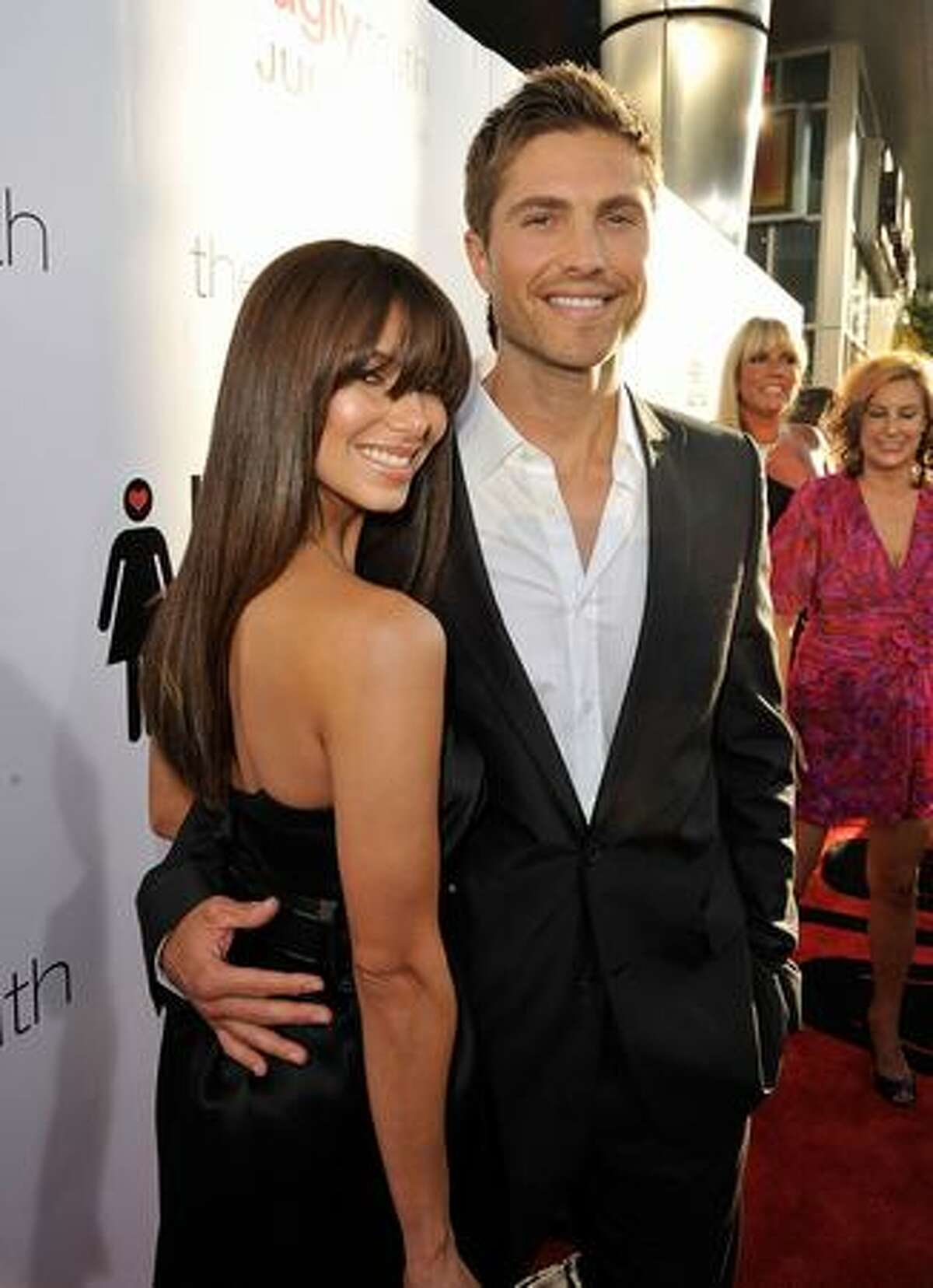 Actress Roselyn Sanchez (L) and actor Eric Winter arrive at the premiere of Columbia Pictures'