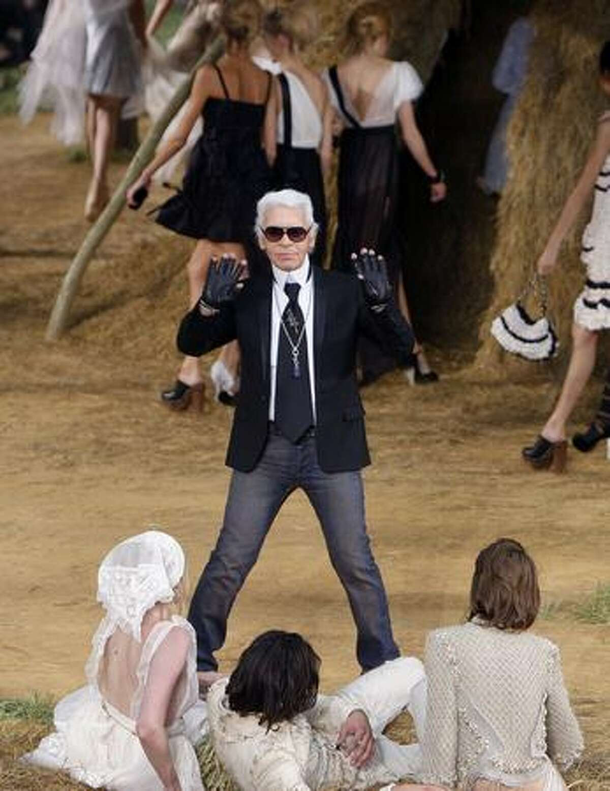 German designer Karl Lagerfeld at the end of his ready-to-wear spring/summer 2010 fashion show for Chanel on Tuesday, Oct. 6, 2009 in Paris.