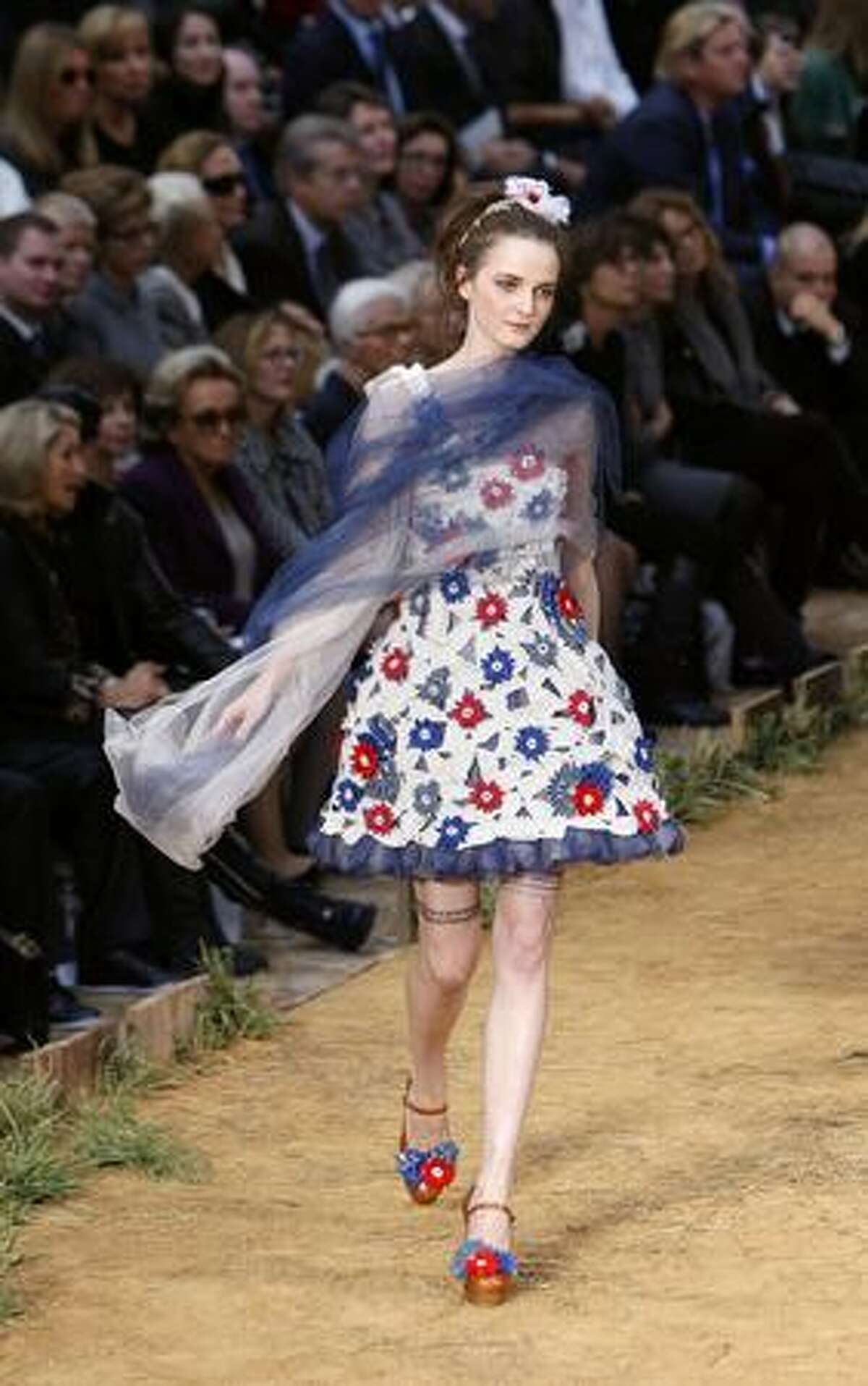 A model presents an outfit by German designer Karl Lagerfeld for Chanel.