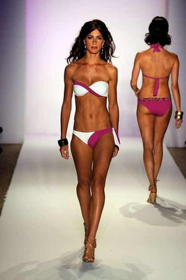 MIAMI BEACH, FL - JULY 17: A model walks the runway at the ANK by Mirla Sabino 2010 fashion show during Mercedes-Benz Fashion Week Swim at the Beachway at The Raleigh on July 17, 2009 in Miami Beach, Florida. Photo: Getty Images